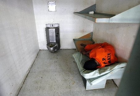 STAFF PHOTO BY MICHAEL DEMOCKER Tuesday, February 26, 2008 Marlin Gusman's tour of Orleans Parish Prison An inmate sleeps in his cell in the 10th floor psychiatric section of Orleans Parish Prison.